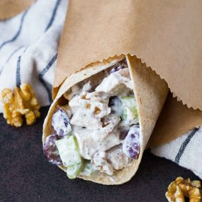 Filling and flavorful, healthy chicken salad with walnuts and grapes is just the thing you're looking for at lunch. Great on a lettuce wrap or tortilla! Get the healthy lunch recipe on RachelCooks.com!