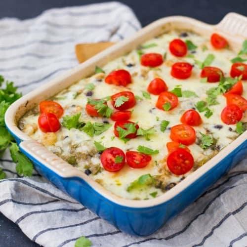 Baked quinoa casserole in blue rectangular baking dish.