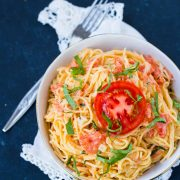 Fresh tomato cream sauce tossed with angel hair pasta is the perfect spring and summer pasta. It's easy to make and is the perfect side next to grilled chicken or fish. Get the easy pasta recipe on RachelCooks.com!