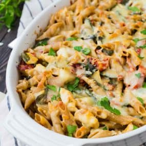 Creamy, flavorful, and healthy, this Chicken Tuscan Pasta Bake is perfect to eat right away or to prep ahead and freeze for another day. Great for sharing with people in need of a meal, too! Get the recipe on RachelCooks.com!