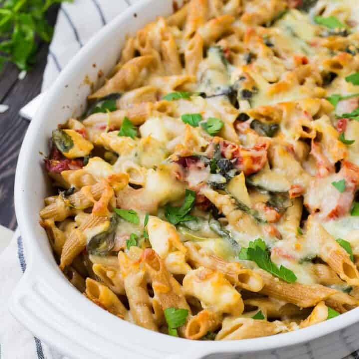 Baked pasta in white oval casserole dish.