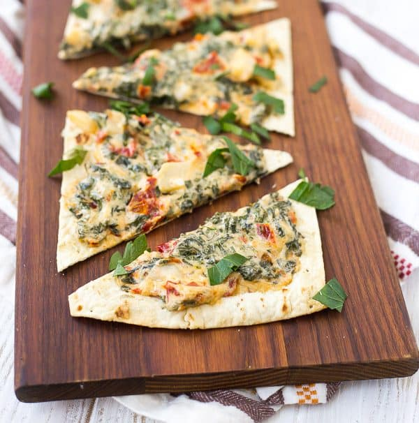 Kale Flatbread with Parmesan and Sundried Tomatoes is a quick and easy lunch or a fun appetizer for any gathering. It's packed with flavor and nutrition!