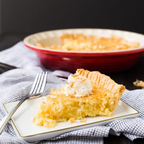 The easiest Coconut Custard Pie recipe -- if I can do it so can you! No prebaking the crust required! This pie recipe will immediately become a favorite! Get the easy pie recipe on RachelCooks.com!