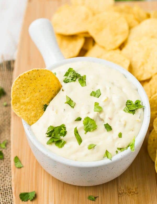 White Queso in the Slow Cooker is easy, Velveeta-free, and you will not be able to stop dipping chips in it! Get the easy slow cooker dip recipe on RachelCooks.com!