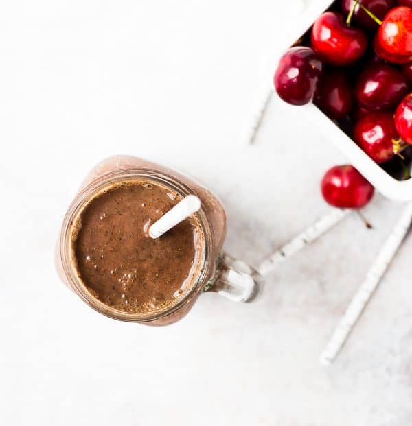 Switch up your smoothie game with this chocolate cherry smoothie. You'll love the black forest flavors in this protein shake - it tastes as good as dessert! Get the recipe on rachelcooks.com!