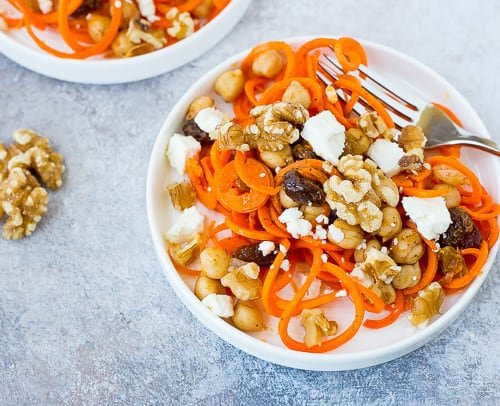 This Moroccan Carrot Noodle Salad with Chickpeas, Feta and Walnuts is flavorful, full of nutrients, and hearty enough to be a full meal! You're going to love this one! Get the recipe on RachelCooks.com!
