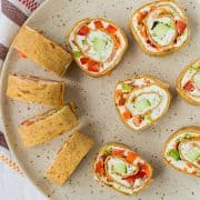 These vegetable cream cheese roll ups are full of crisp vegetables, flavorful herbs, and smooth cream cheese. They make a great lunch or snack thanks to extra protein in the wrap! Get the easy recipe on RachelCooks.com!