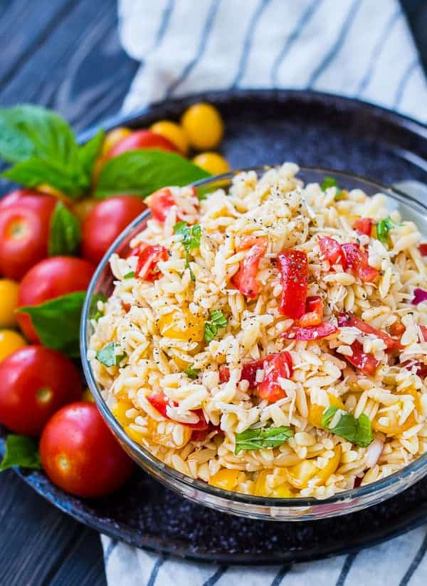 Partial image of pasta salad in bowl.