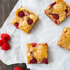 Ultra-moist raspberry white chocolate blondies are absolutely irresistible. You won't believe how easy they are to make! Get the recipe on RachelCooks.com!