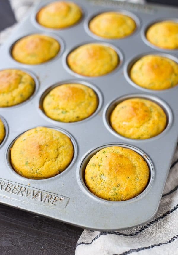 This Cornbread Muffin Recipe with Herbs and Cheddar takes your standard corn muffins up a notch thanks to flavorful herbs and rich, sharp cheddar. They're perfect with a bowl of chili! Get the easy muffin recipe on RachelCooks.com!