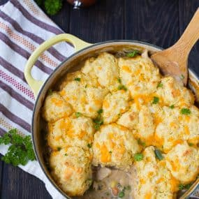 Cozy and comforting, this one pan Chicken Stew with Cornmeal Biscuits is easy to make and even easier to eat! Your whole family will love this new take on a classic.Get the recipe on RachelCooks.com!