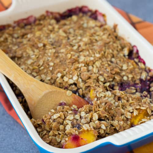 This peach blueberry crisp can be made with fresh or frozen fruit, making it a perfect dessert all year round! It's perfect with a scoop of vanilla ice cream. Get the easy recipe on RachelCooks.Com!