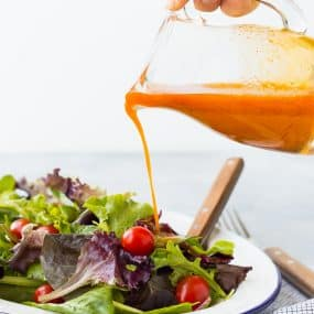 Sweetened and flavored with carrot juice, this vinaigrette salad dressing is free of added sugars but not short on flavor! It's great on salads with southwestern toppings! Get the recipe on RachelCooks.com!