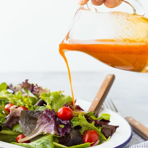 Sweetened and flavored with carrot juice, this vinaigrette salad dressing is free of added sugars but not short on flavor! It's great on salads with southwestern toppings!Get the recipe on RachelCooks.com!