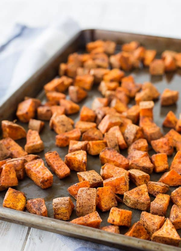 Front view closeup of sweet potatoes in roasting pan.