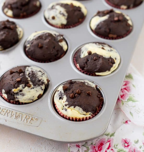 Can you think of a better way to start your day than with a decadent chocolate muffin with ribbons of cream cheese running through it? These chocolate cream cheese muffins make for happy, happy mornings! Get the recipe on RachelCooks.com!