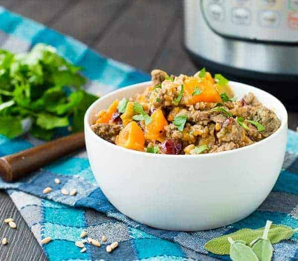 Great any day as a complete meal, or as a Thanksgiving side, this Instant Pot Farro Stuffing with Sausage and Sweet Potatoes is flavorful, warm and filling. - Get the easy pressure cooker recipe on RachelCooks.com