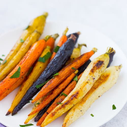 Roasted whole carrots not only offer a stunningly gorgeous presentation, but also come with the bonus that you don't need to chop anything!Get the easy method on RachelCooks.com!