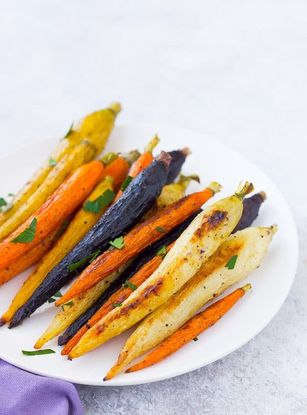 Roasted whole carrots not only offer a stunningly gorgeous presentation, but also come with the bonus that you don't need to chop anything! Get the easy method on RachelCooks.com!