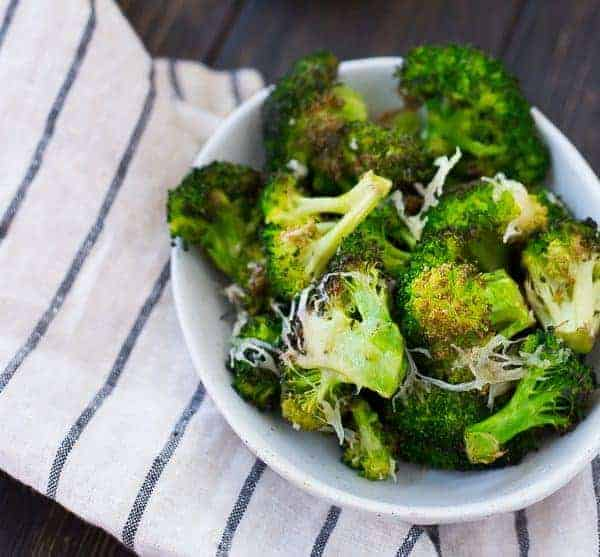 When you bite into crispy Roasted Parmesan Broccoli you'll feel like you're eating a treat, not something packed with healthy nutrients! It's going to become a fast favorite. Get the recipe on RachelCooks.com!