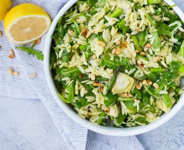 This spring orzo salad is full of bright and fresh flavors that will make you happy from the very first bite! Crisp asparagus, spicy arugula, and flavorful pine nuts are all dressed in a springy basil lemon vinaigrette. It's a huge hit every time! Make it for your next party, you won't regret it!