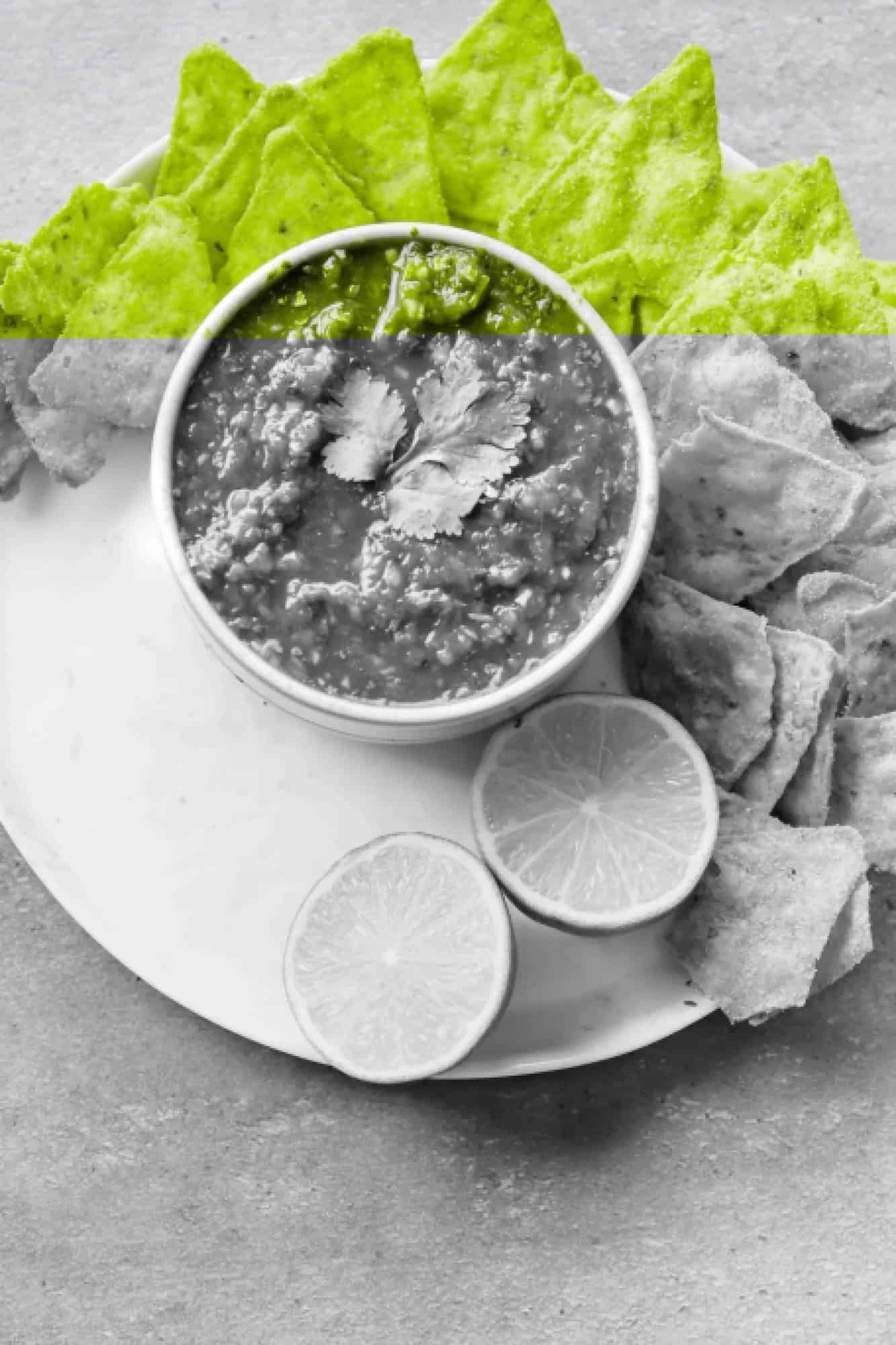 restaurant style salsa photo with chips and lime halves