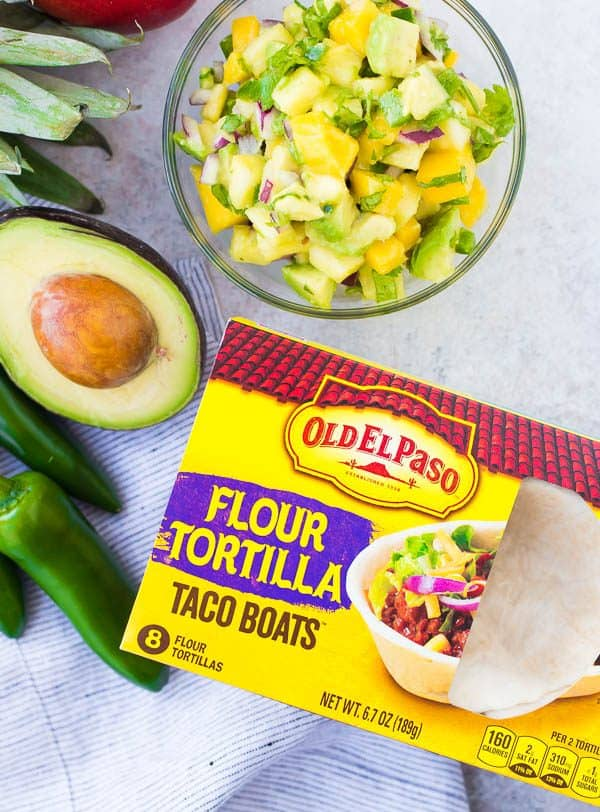 These Shrimp Tacos are a refreshing taste of the tropics thanks the zesty avocado, mango and pineapple salsa. They're easy to make and are a hit for any party or taco night. The extra salsa is amazing on chips or sprinkled on a salad! Get the quick and easy taco recipe on RachelCooks.com!