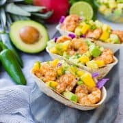 These Shrimp Tacos are a refreshing taste of the tropics thanks the zesty avocado, mango and pineapple salsa. They're easy to make and are a hit for any party or taco night. The extra salsa is amazing on chips or sprinkled on a salad!