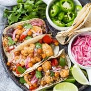 These easy vegetarian cauliflower tacos are full of flavor and protein! Even meat-lovers are going to flip over these fun tacos. Whether it's for Meatless Monday or a full-on vegetarian lifestyle, you're going to love these! They're also easy to make vegan. Make them tonight!