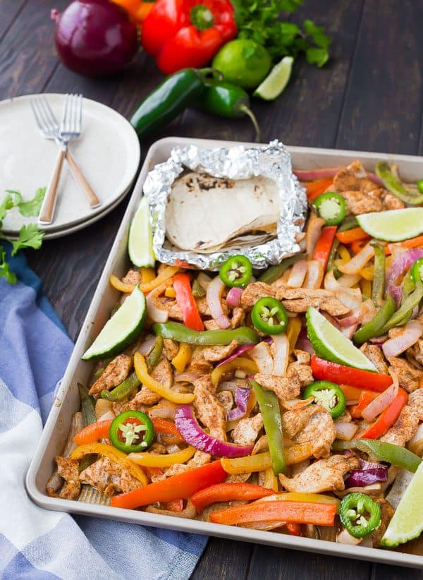 Sheet pan fajitas are great for busy weeknights and also great for bigger crowds! You'll love this easy, hands-off approach to fajitas! This recipe is for chicken fajitas but you'll also find tips for steak, vegetarian, and shrimp fajitas! Get the recipe on RachelCooks.com!