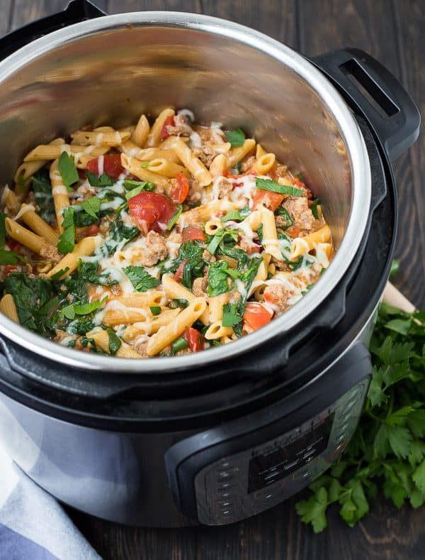 A complete pasta dinner, made in your Instant Pot! You'll love this Instant Pot Pasta with Sausage, Spinach, and Tomatoes. You might have all the ingredient on hand already! It's healthy, satisfying, easy, and versatile, and you're going to keep making it again and again!