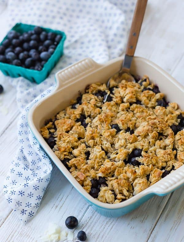 image of blueberry crisp in a blue dish