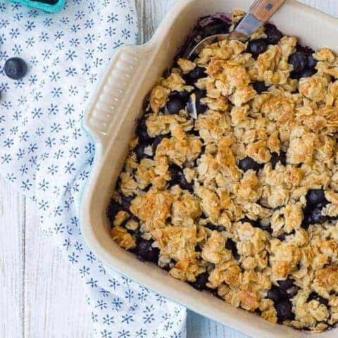 This blueberry crisp with coconut is a fun and delicious twist on plain blueberry crisp - you'll love the additional layer of crisp and the flavor that the coconut adds. The only question is, will you eat it for breakfast or dessert?