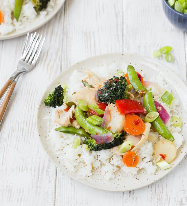 This sweet chili chicken stir fry is a quick and easy healthy dinner that comes together in 30 minutes, is so full of flavor, and is flexible based on what vegetables you have on hand! Get the recipe on RachelCooks.com