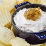 image of homemade french onion dip surrounded by chips