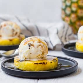 This grilled pineapple with caramel toffee crunch ice cream is the perfect simple summer dessert. Everyone loves it, you can make it in about 10 minutes, and it cooks on the grill so you don't have to heat up the house!