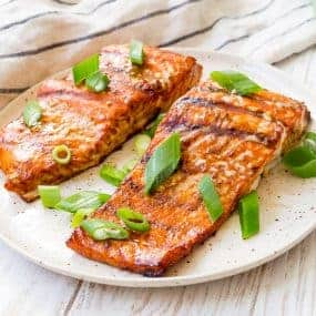 This is the best grilled salmon recipe! The marinade makes the fish so flavorful and it's ridiculously easy to make! It's going to become your go-to salmon recipe!