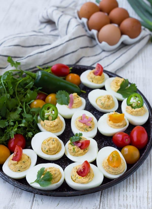 Image of Southwest Deviled Eggs on black platter with garnishes