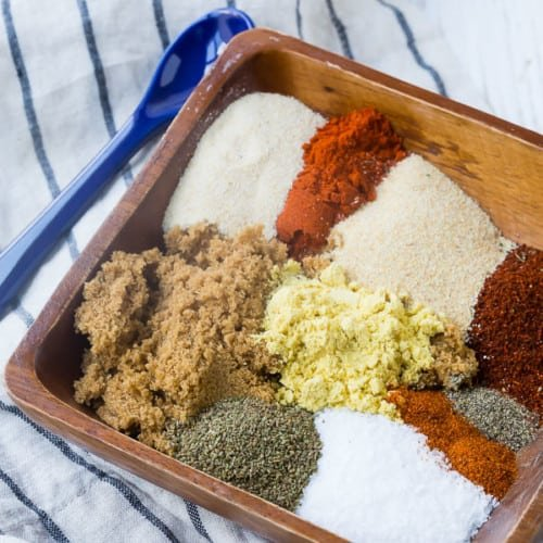 Ingredients of bbq rub in small wooden dish.
