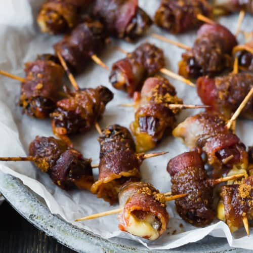 These bacon wrapped dates are stuffed with fontina cheese and sprinkled with an insanely delicious brown sugar spice rub. They're going to be the hit of your next party!