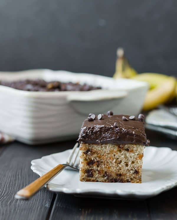 This banana cake is ultra-moist, flecked with chocolate chips, and topped with a thick layer of chocolate cream cheese frosting. It's going to become a quick favorite!