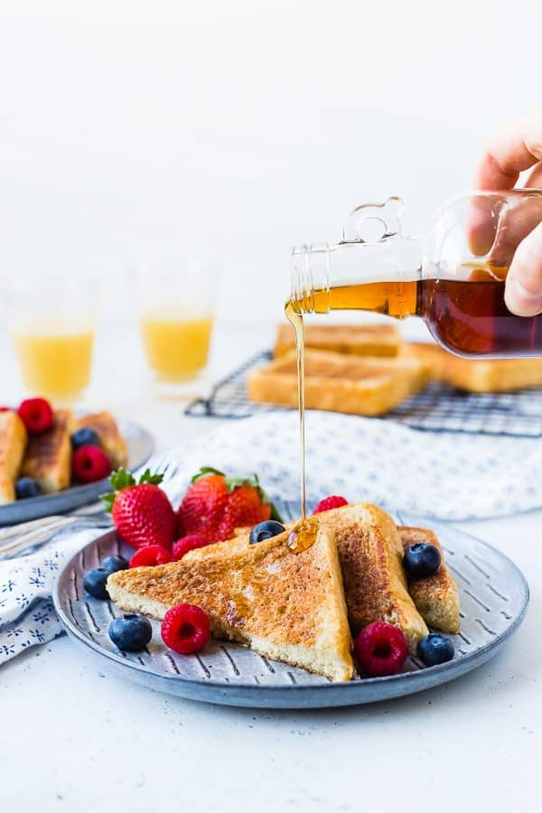 Image of classic french toast with syrup being poured on top of it