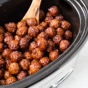 These crockpot meatballs only require 5 ingredients and are always the hit of any party. Let your slow cooker do the work on this recipe - the result is delicious!