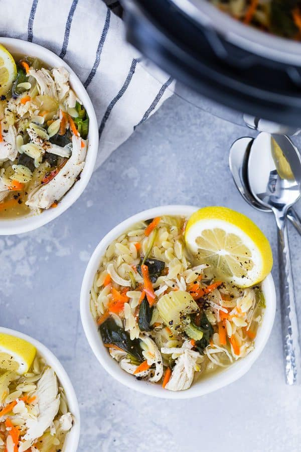 Image of Instant Pot Lemon Chicken Orzo Soup taken from above with spoons