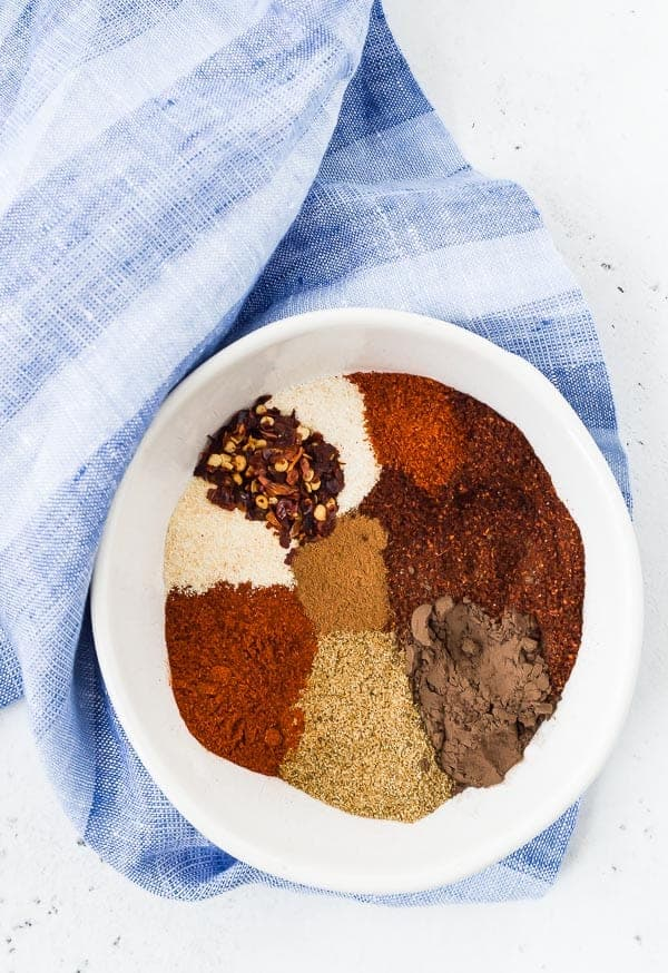 Overhead view of spices in a white bowl.