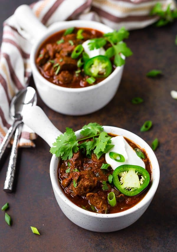 Rich and full of warm heat, this slow cooker Texas chili will instantly become your favorite chili recipe. The big chunks of beef will fall apart in your mouth!