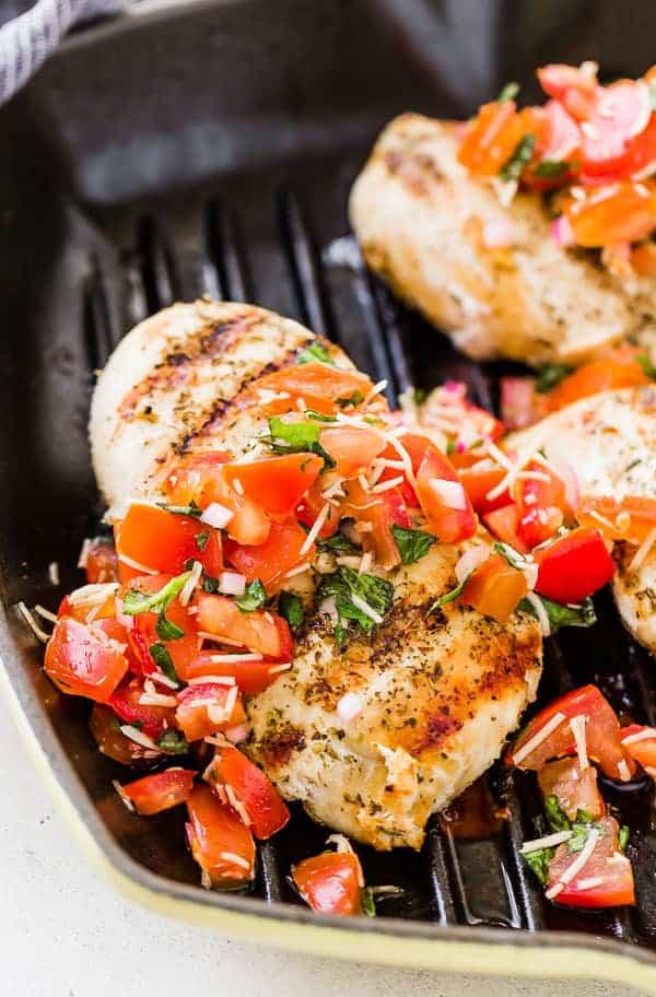 Partial image of bruschetta chicken in grill pan.
