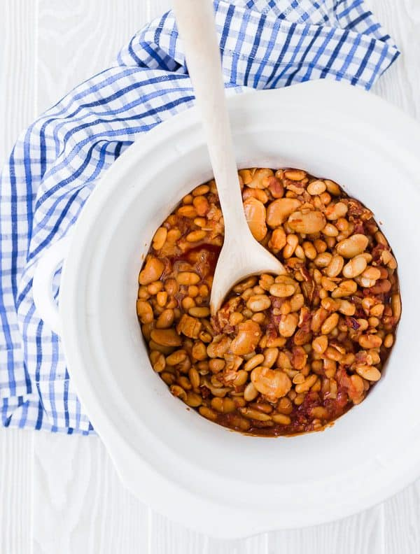 The perfect blend of tangy and sweet, these crock pot baked beans are perfect for any BBQ or party! They'll stay warm all evening, but they'll disappear quickly!