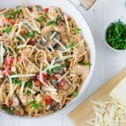 This creamy chicken spaghetti is made in one pan and is endlessly versatile. It's a great clean-out-the-fridge meal!