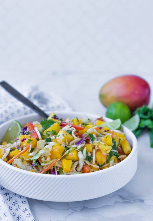 This mango slaw is the perfect slaw for fish tacos, but you'll find yourself eating it all by itself too, because it is that good!